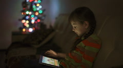 Little Girl Playing Games on Tablet Computer - stock footage
