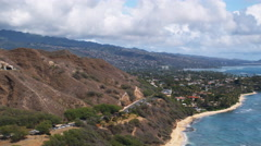 Flying along hilly Waialae-Kahala coastline. Shot in 2010. Stock Footage