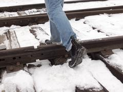 Step over the rails, walk on the sleepers Stock Photos
