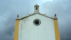 Symmetrical spooky scary church chapel, clouds and dark sky, Portugal - stock footage