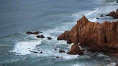 Sharp rocky cliffs, Atlantic ocean waves, Portugal Stock Footage