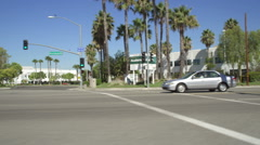 Left Front Three Quarter view of a Driving Plate: Car turns right onto Brea Stock Footage