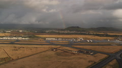 Approaching Lihue Airport at sunrise with rainbow, Hawaii. Shot in 2010. - stock footage