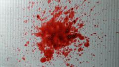 Blood splash on frosted glass Stock Footage