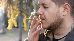 White man drug addict smoking weed, detail of his mouth Stock Footage