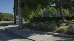 Right Front Three Quarter view of a Driving Plate: Car turns right onto Brea Stock Footage