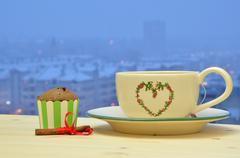 Wintry Tea with Chocolate Muffin - stock photo
