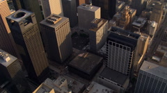 Flight over Houston skyscrapers with tilt-up to view of area beyond downtown. - stock footage