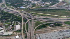 High orbit above freeway interchanges in Houston. Shot in 2007. Stock Footage