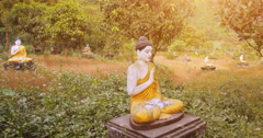 1000 Buddhas garden in Hpa An, Myanmar. Peaceful religious sunset background Stock Footage