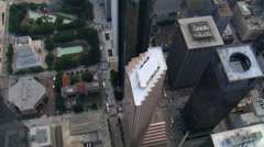 Slow flight with steep view down above buildings of downtown Houston; links to Stock Footage