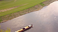 Stock Video Footage of Aerial view of a floating boat on the river Elbe in Saxony, Germany