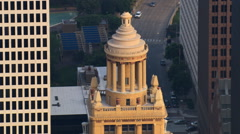 Slow flight past colonnaded cupola atop Esperson Building in downtown Houston. Stock Footage