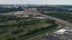 Wide aerial approach across freeway toward downtown Houston. Shot in 2007. Stock Footage