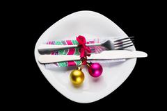 Set of silverware on the white plate - stock photo