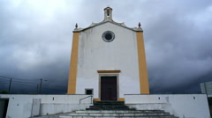 Spooky scary church chapel, clouds and dark sky, long shot, Portugal Stock Footage