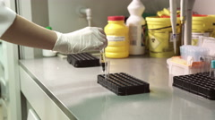 Test-tube with blood for testing and analysis at modern medical laboratory Stock Footage