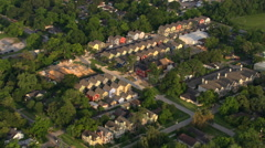 Flight over row houses and the suburbs of Houston. Shot in 2007. Stock Footage