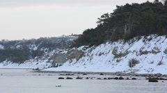 Eroded limestone coastline on the island of Gotland in Sweden wintertime Stock Footage