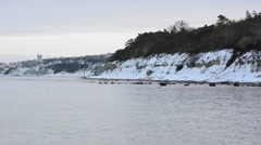 Stock Video Footage of Eroded limestone coastline on the island of Gotland in Sweden wintertime