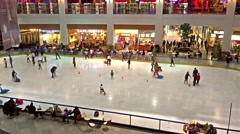Stock Video Footage of Children Learning To Skate On Skating Ring Interior