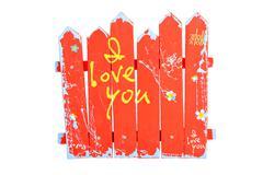 Wooden red souvenir handmade fence on white Stock Photos