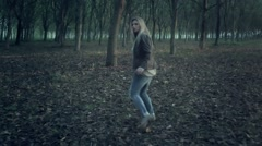 scared woman running away through the forest slow motion - stock footage