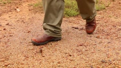 Hunter in Africa - Walking , only feet - stock footage