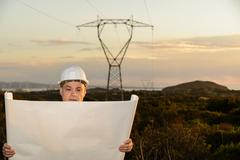 Electrical Engineer Controls the Power Line. - stock photo