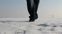 Man walking on a frozen lake in danube delta Stock Footage