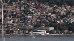 Sailing boat with Favela in the Background - stock footage