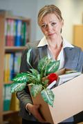 Redundant Businesswoman In Office - stock photo