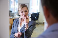 Aggressive Businesswoman Shouting At Male Colleague Stock Photos