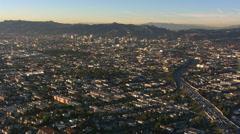 High flight across Los Angeles toward hills. Shot in 2008. Stock Footage