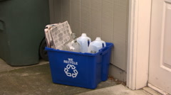 Recycle bin near door, girl adds glass jars - stock footage
