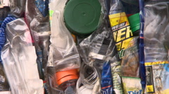 Plastic recycle bales awaiting further processing - stock footage