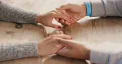 Young romantic mixed race couple excited nervous holding hands - stock footage