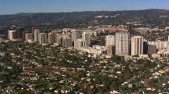 Flying toward and over high rise apartments on Wilshire Boulevard near Los Stock Footage