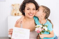 Daughter hugs and greets her mom - stock photo