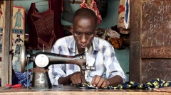 Africa native village tailor shop Stock Footage