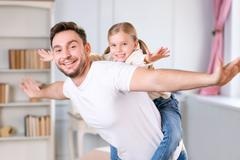 Vivacious father and daughter laying together Stock Photos