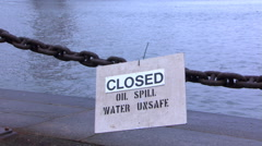 From water contamination warning, view tilts up to nearby Golden Gate Bridge Stock Footage