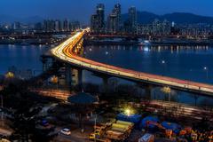 Rush hour traffic over Cheongdam bridge - stock photo