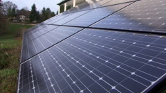 Residential free-standing solar panels beside a house, close view - stock footage