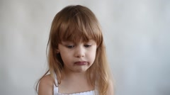 Little girl chewing something Stock Footage