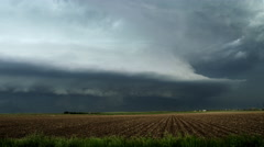 Huge shelf cloud out ahead of a cool outflow of air from a thunderstorm over - stock footage