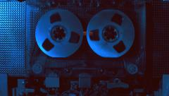 Rotation reel of vintage audio cassette is glistens in the light. Macro - stock footage