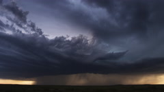Thunderstorm with pouring rain and multiple lightning flashes over prairie, time - stock footage