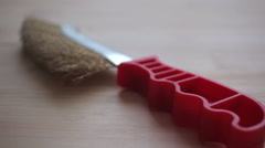 Wire brush tool isolated on wooden table Stock Footage