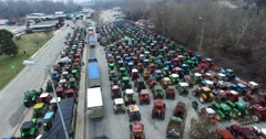 Tractors that have lined up the farmers at the border of Greece with Bulgaria Stock Footage